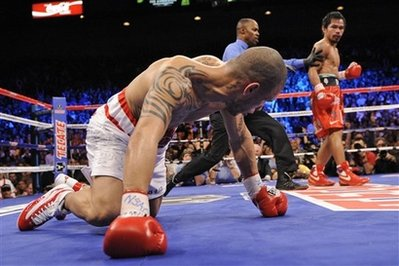 Manny Pacquiao Knocks Down Miguel Angel Cotto